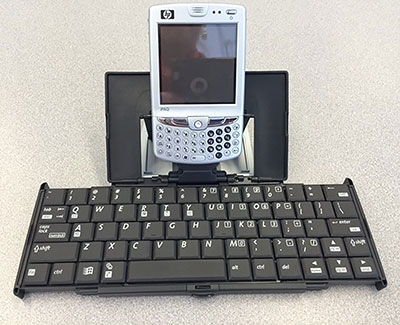 a mobile device attached to a portable keyboard